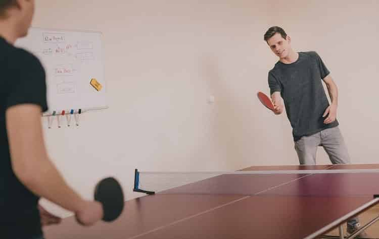 two friends playing table tennis